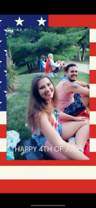 Smiling woman and man, sitting outside on the 4th of July