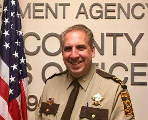 Smiling man in uniform.