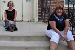 2 women sitting on steps