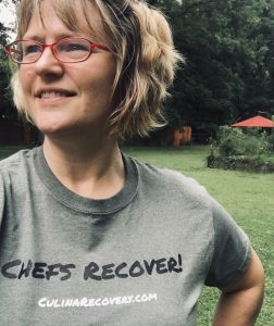 "Woman wearing a ""Chefs Recover"" t-shirt"