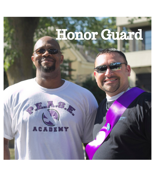 Two men wearing purple honor guard sash