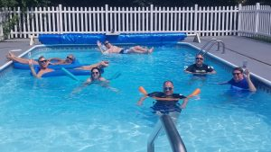 7 people in a swimming pool