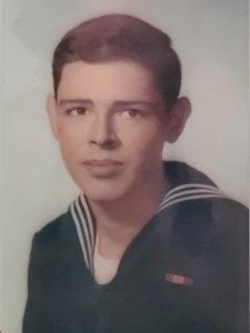 Young man in U.S. Navy uniform.