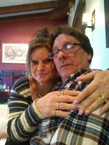Woman hugging her husband.