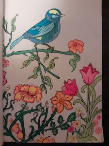 Drawing of a blue bird perched on colorful flowers