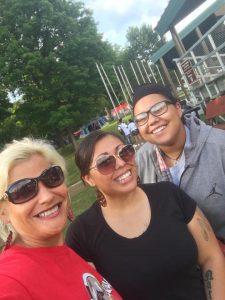 Three women smiling.
