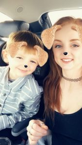 Woman and son, pretending to be puppies