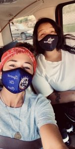 Two women wearing Sober Squad masks