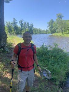 Smiling man standing outside near river