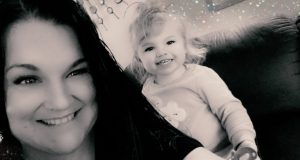 Black and white photo of woman with small child