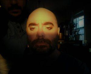Selfie of man in shadow
