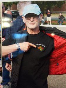 Man pointing at a logo on his t-shirt